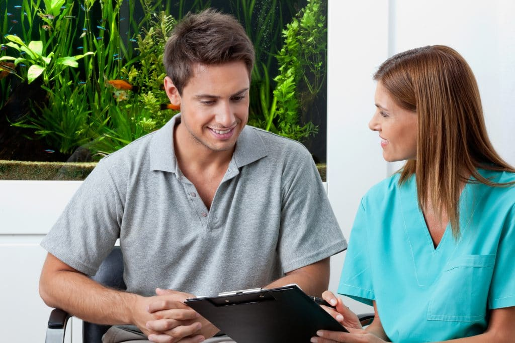 sacramento wellness dentistry discussing dental payment options with patient