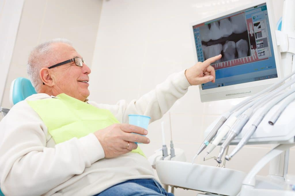 sacramento wellness dentistry male dental patient looking at films